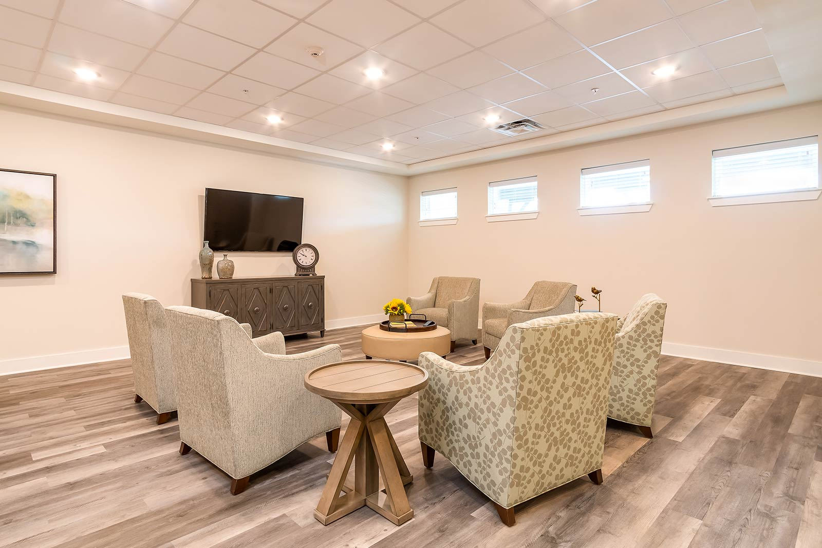 Lounge Area With TV, Couches And Chairs In Our Warner Robins GA Assisted Living And Memory Care Community