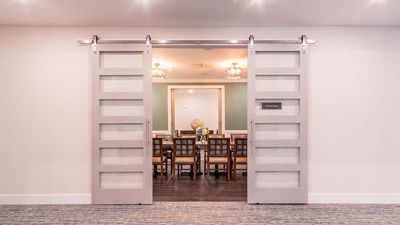 Sliding Barn Doors Leading To Private Dining Room For Special Occasions